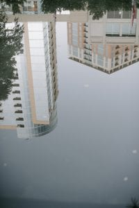 View of two Dallas skyscrapers, upside down, how it looks from a reflection on a pond