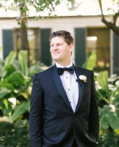 Groom on his wedding day, waiting in a garden